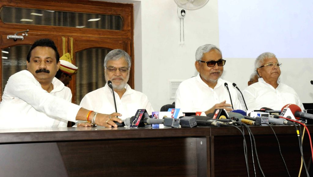 Bihar Chief Minister Nitish Kumar, RJD chief Lalu Prasad Yadav, Congress leader C. P. Joshi and others addresses a press conference in Patna on Aug 12, 2015. - Nitish Kumar, Lalu Prasad Yadav and C. P. Joshi