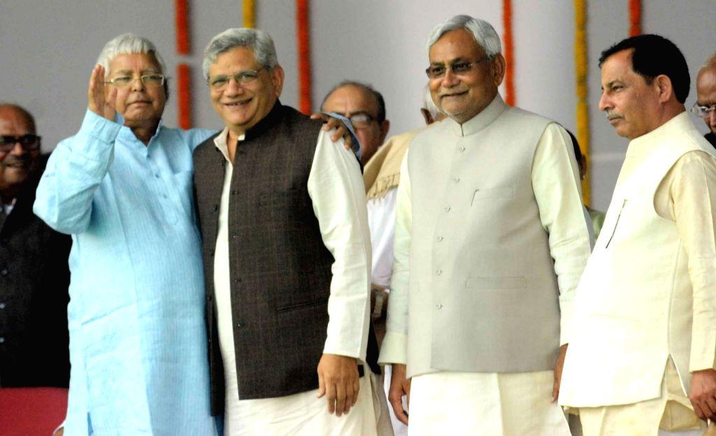 Bihar Chief Minister Nitish Kumar, RJD chief Lalu Prasad Yadav and CPI-M general secretary Sitaram Yechury  during the swearing-in ceremony of the new JD-U-RJD-Congress coalition government in ... - Nitish Kumar, Sitaram Yechury and Lalu Prasad Yadav