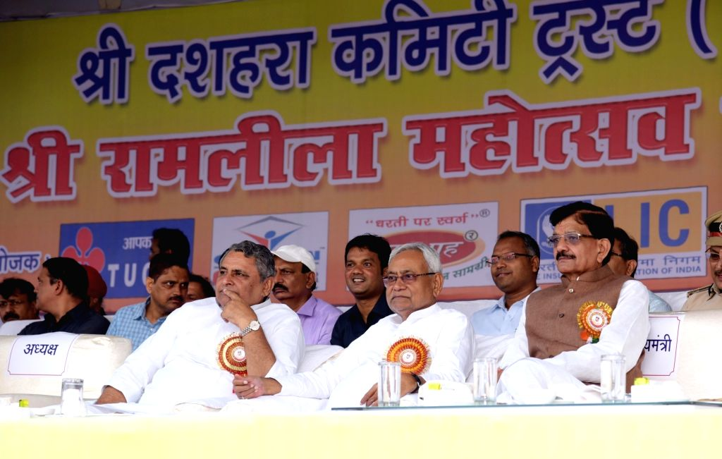 Bihar Chief Minister Nitish Kumar, state Assembly Speaker Vijay Kumar Chaudhary and Congress leader Madan Mohan Jha at 'Ramleela Mahotsav' during Dussehra celebrations in Patna, on Oct 8, 2019. - Nitish Kumar and Vijay Kumar Chaudhary