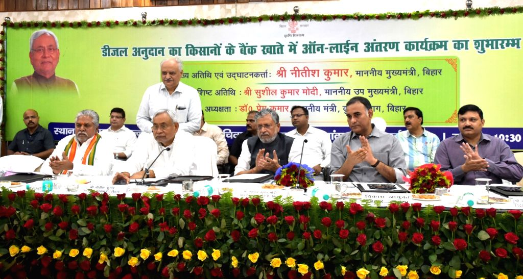 Bihar Chief Minister Nitish Kumar, the state's Deputy Chief Minister Sushil Kumar Modi, Bihar Agriculture Minister Prem Kumar and other dignitaries during programme organised by the state's ... - Nitish Kumar, Sushil Kumar Modi and Prem Kumar