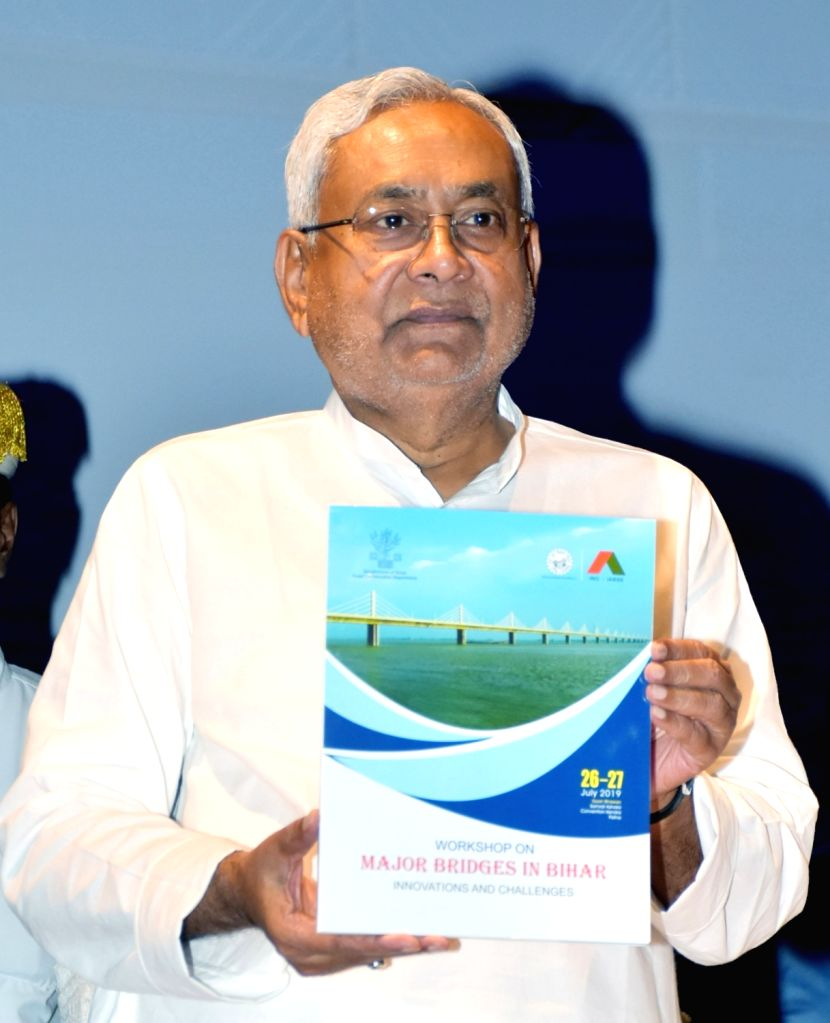 Bihar Chief Minister Nitish Kumar unveils a publication during a seminar on 'Major Bridges in Bihar', in Patna on July 26, 2019. - Nitish Kumar