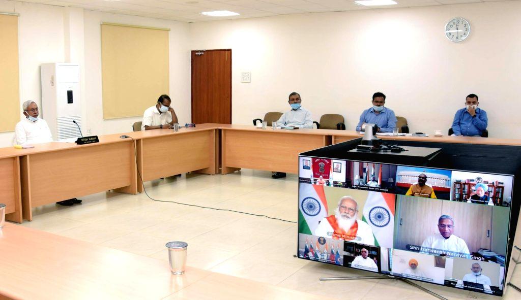 Bihar Chief Minister Nitish Kumar via video conferencing Prime Minister Narendra Modi attend a meeting of high level committee to commemorate 400th birth anniversary of Sri Guru Tegh Bahadur, ... - Nitish Kumar and Narendra Modi