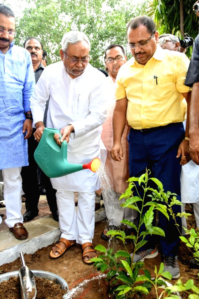Bihar Chief Minister Nitish Kumar waters a sapling at the inauguration of a statue of freedom fighter Ram Ekbal Singh Warsi on his death anniversary, in Patna on Oct 10, 2019. - Nitish Kumar and Ekbal Singh Warsi