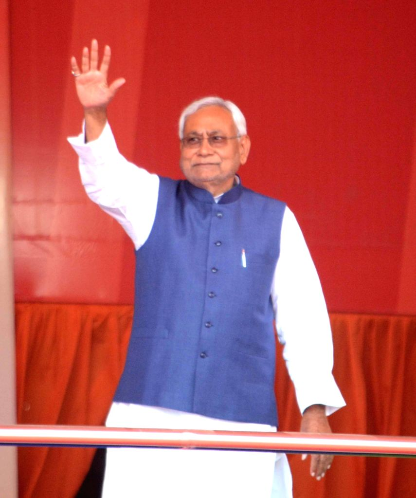 Bihar Chief Minister Nitish Kumar waves to the crowd at 'Sankalp Rally' in Patna, on March 3, 2019. - Nitish Kumar