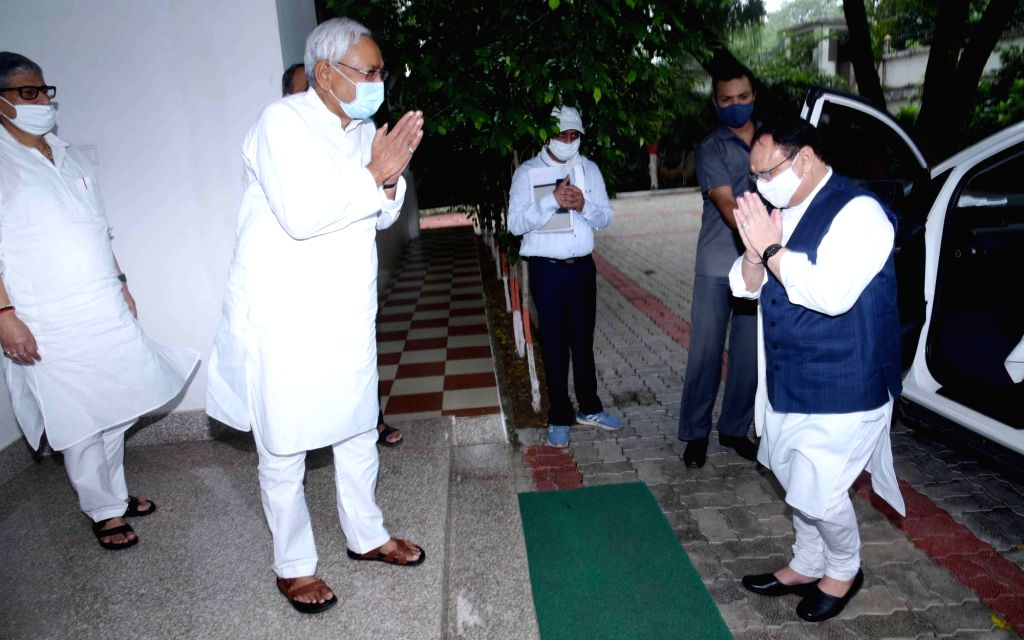 Bihar Chief Minister Nitish Kumar welcomes BJP National President JP Nadda on his arrival to meet the former at his residence, in Patna on Sep 12, 2020. - Nitish Kumar
