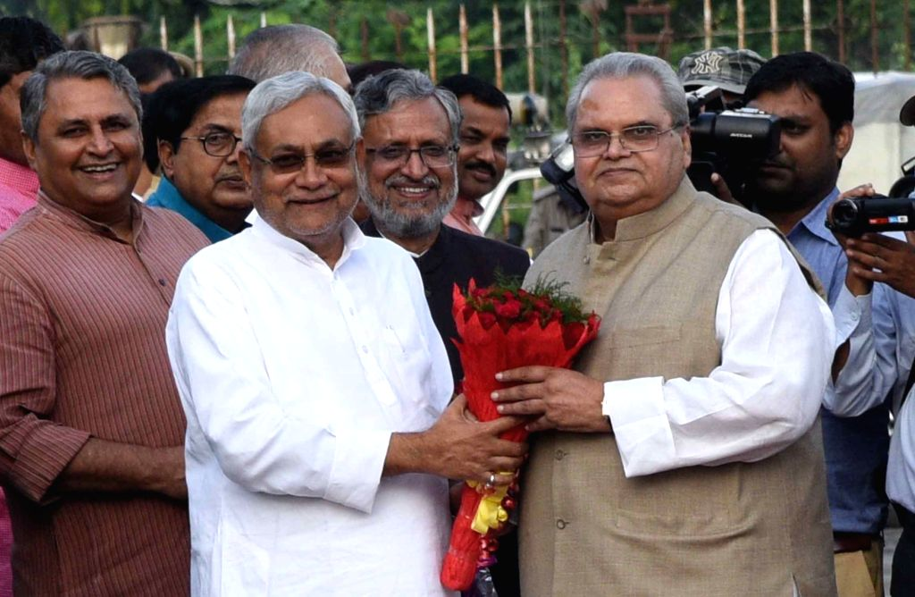 Bihar Chief Minister Nitish Kumar welcomes newly appointed Governor of the state Satyapal Malik in Patna on Oct 3, 2017. - Nitish Kumar and Malik