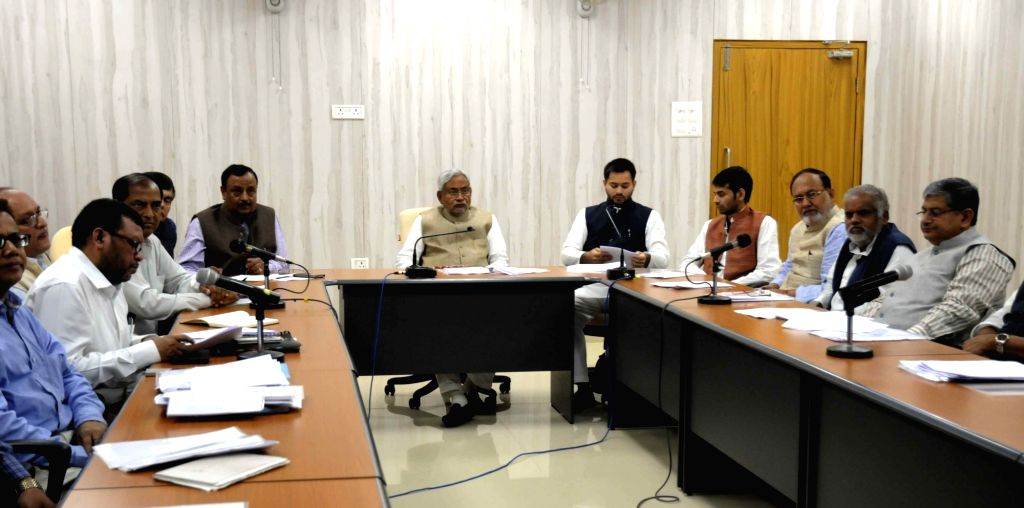 Bihar Chief Minister Nitish Kumar with Deputy Chief Minister and Heath Minister during a meeting in Patna on Nov 24, 2015.