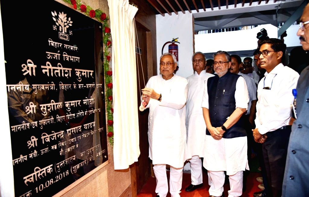 Bihar Chief Minister Nitish Kumar with Deputy Chief Minster Sushil Kumar Modi unveils the plaque to lay foundation stone of a library at Bihar power department, in Patna on Aug 10, 2018. - Nitish Kumar