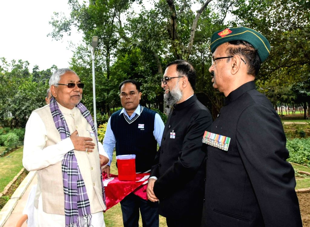 Bihar Chief Minister Nitish Kumar with Home Secretary Amir Subhani on the occasion of Flag Day in Patna on Dec. 7, 2019. - Nitish Kumar
