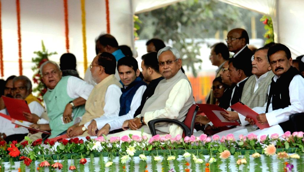 Bihar Chief Minister Nitish Kumar with RJD leaders Tejashwi Yadav and Tej Pratap Yadav and others during the swearing-in ceremony of the new JD-U-RJD-Congress coalition government in Patna, on ... - Nitish Kumar, Tejashwi Yadav and Tej Pratap Yadav