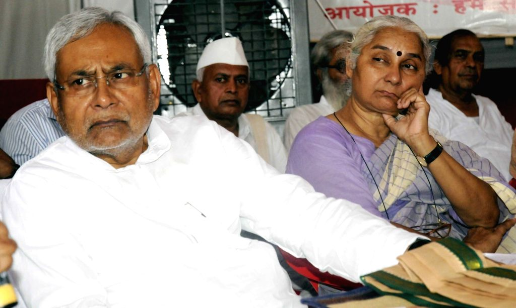 Bihar Chief Minister Nitish Kumar with social activist Medha Patkar during a programme organised to celebrate 82nd anniversary of Socialist Movement in Patna, on May 17, 2016. - Nitish Kumar