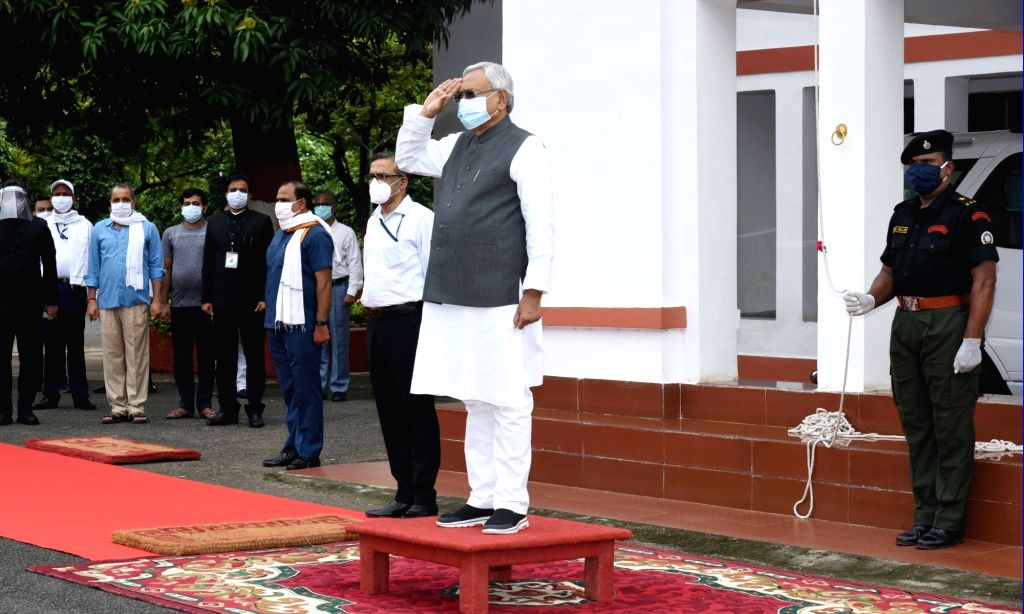 Bihar Chief Minister takes salute during the flag hoisting ceremony at his residence on the 74th Independence Day, in Patna on Aug 15, 2020.