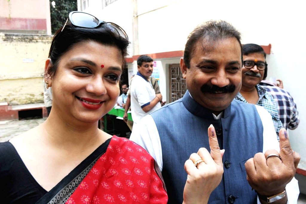 Bihar Congress chief Ashok Choudhary with his wife show their finger marked with phosphorous ink after casting their vote during the third phase of Bihar assembly polls in Patna on Oct 28, ...