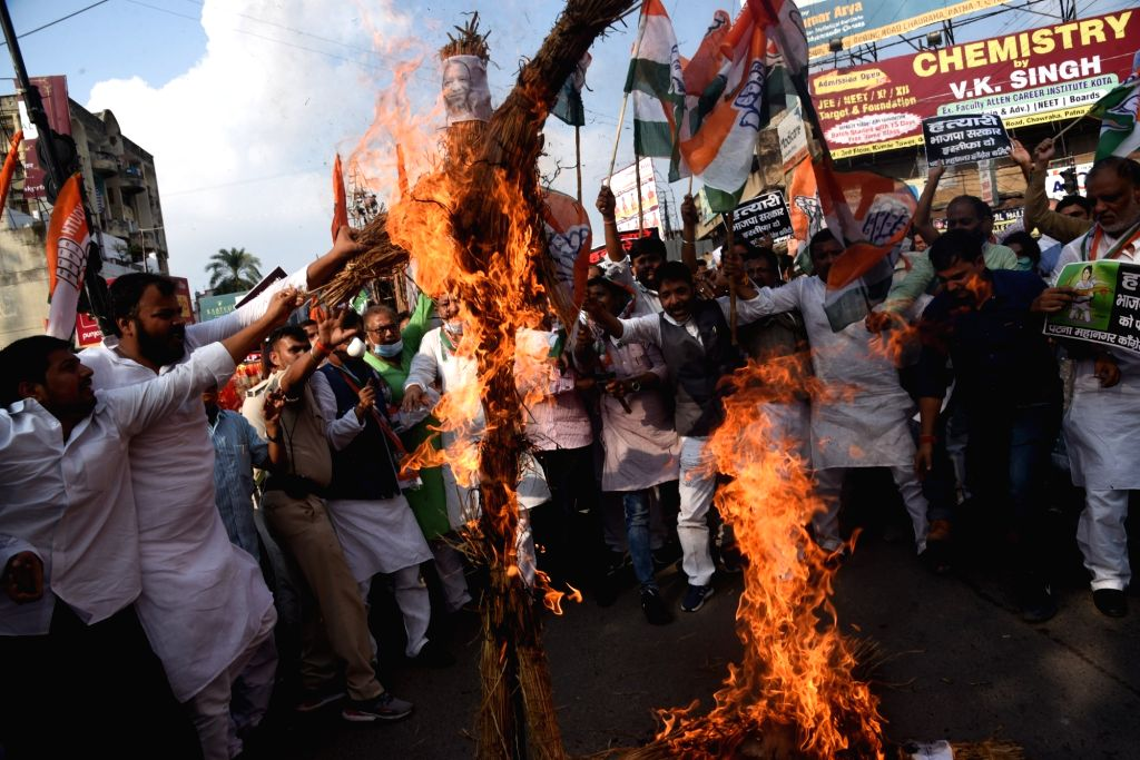 Bihar Congress Workers protesting against Sunday???s killing of four farmers in Uttar Pradesh Lakhimpur Khera and burn an effigy of Prime Minister Narendra Modi in Patna on Tuesday Oct. 5, ... - Narendra Modi