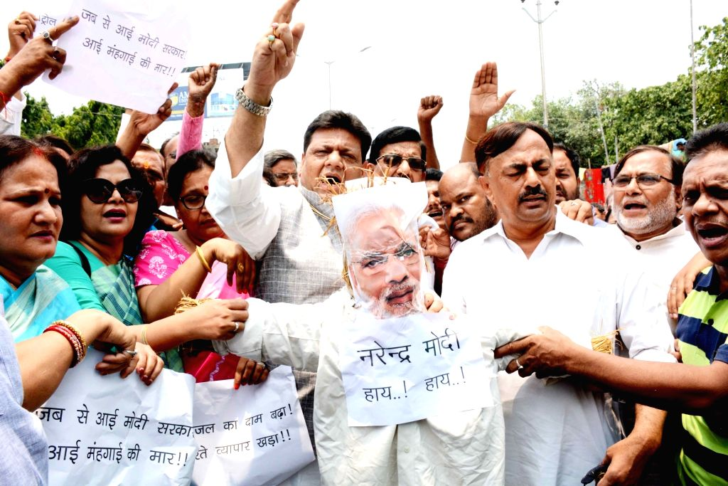 Bihar Congress Working President Kaukab Qadri and party workers stage a demonstration against the hike in petrol and diesel prices, in Patna on May 23, 2018.