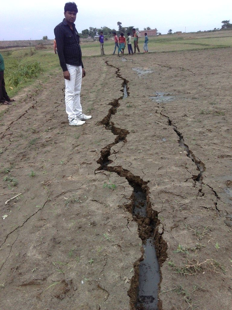 Cracks develop on the ground after earthquake jolts Northern India on April 25, 2015.