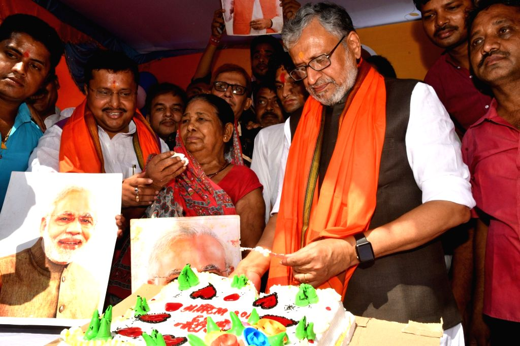 Bihar Deputy Chief Minister and BJP leader Sushil Kumar Modi during a programme organised to celebrate Prime Minister Narendra Modi's birthday in Patna on Sept 17, 2018. - Narendra Modi and Sushil Kumar Modi