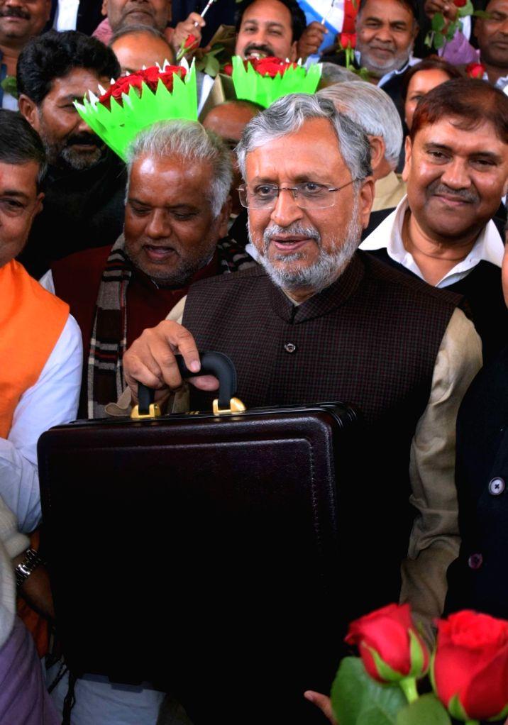 Bihar Deputy Chief Minister and Finance Minister Sushil Kumar Modi arrives at state assembly to present 2019-20 budget in Patna on Feb 12, 2019. - Sushil Kumar Modi