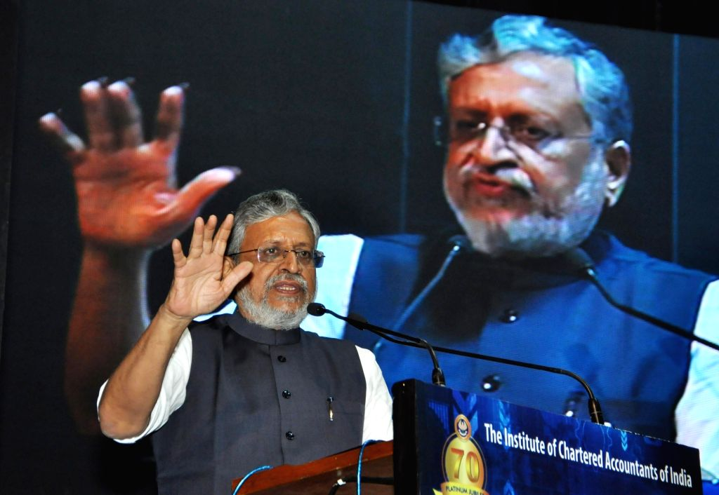 Bihar Deputy Chief Minister and GST Network panel head Sushil Modi addresses during a national seminar organsied by Institute of Chartered Accountants of Indiaon Goods and Services Tax ... - Sushil Modi