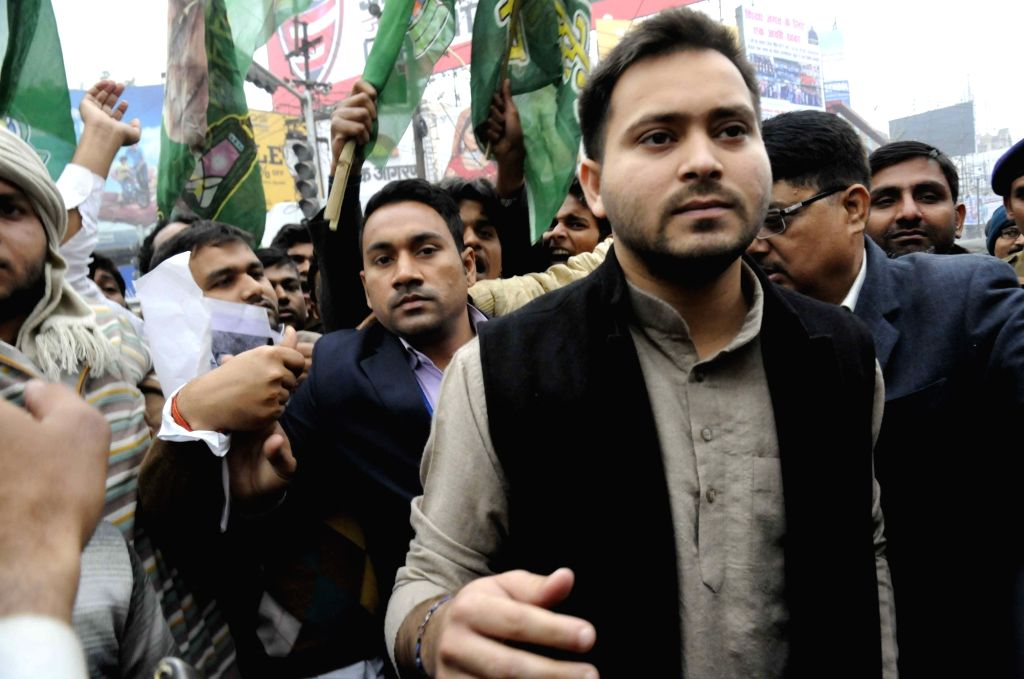 Bihar Deputy Chief Minister and RJD leader Tejashwi Yadav participates in a rally organised to demand justice for  Rohith Vemula, a Dalit research scholar of the University of Hyderabad who ... - Tejashwi Yadav