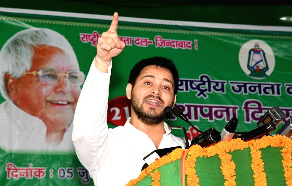 Bihar Deputy Chief Minister and RJD leader Tejashwi Yadav addresses during party's foudation day programme in Patna on July 5, 2017. - Tejashwi Yadav