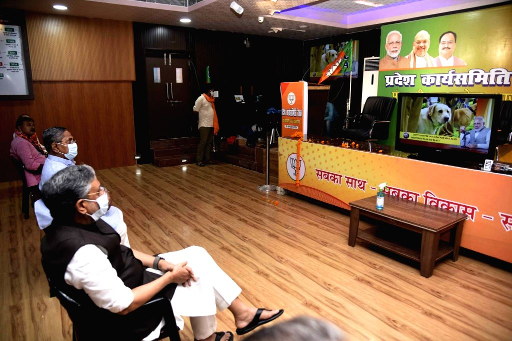 "Bihar Deputy Chief Minister Sushil Kumar Modi seen listening to PM Modi's ""Mann Ki Baat"" with other BJP members at BJP office, in Patna on August 30, 2020. - Sushil Kumar Modi"