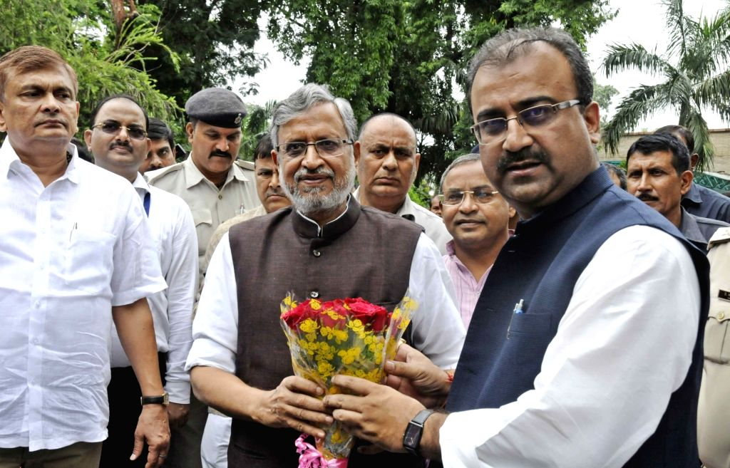 Bihar Deputy Chief Minister Sushil Kumar Modi along with Bihar Health Minister Mangal Pandey during the launch of ambulance services in Patna on Aug 12, 2017. - Sushil Kumar Modi and Mangal Pandey