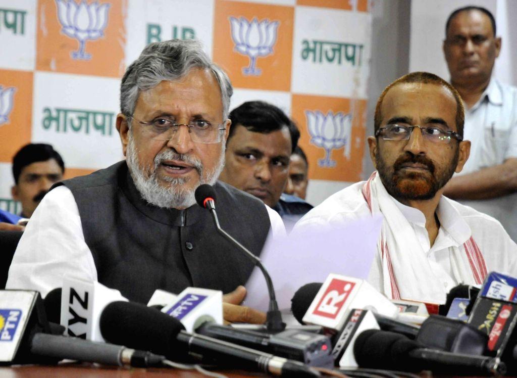 Bihar Deputy Chief Minister Sushil Kumar Modi addresses a press conference at the BJP office in Patna on Aug 18, 2017. - Sushil Kumar Modi