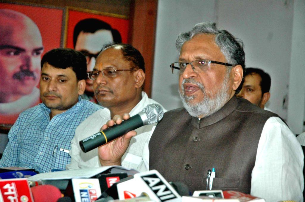 Bihar Deputy Chief Minister Sushil Kumar Modi addresses a press conference in Patna on Aug 20, 2017. - Sushil Kumar Modi