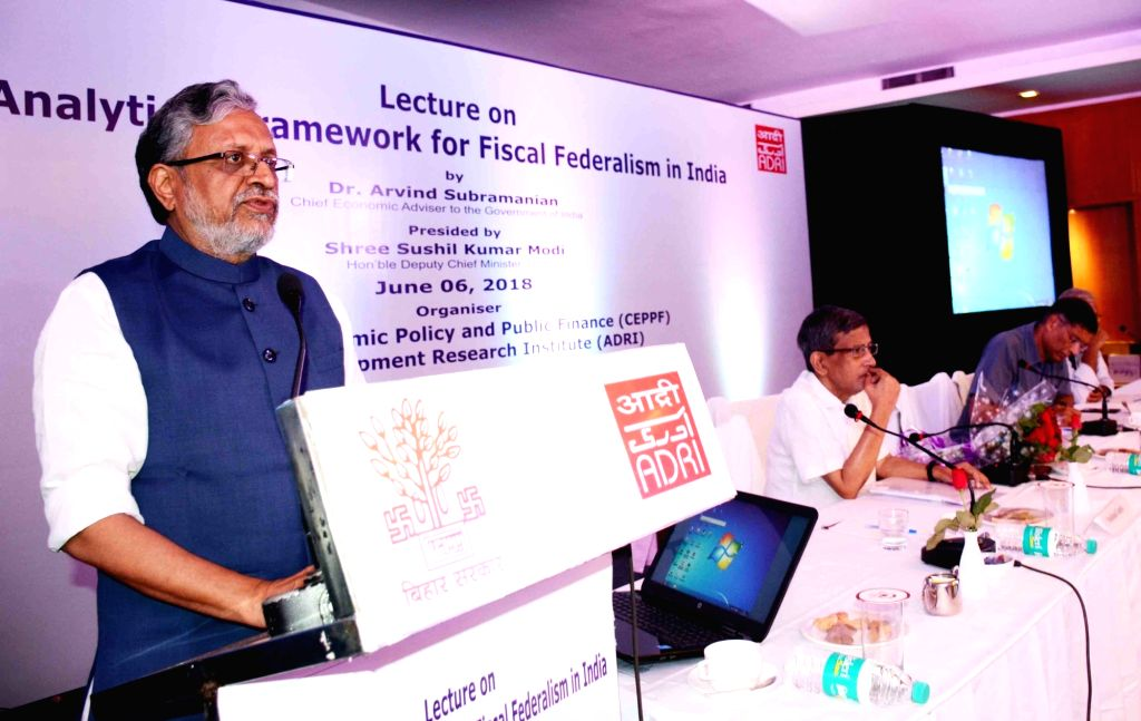 Bihar Deputy Chief Minister Sushil Kumar Modi addresses during a seminar organised by Asian Development Research Institute (ADRI), in Patna on June 6, 2018. - Sushil Kumar Modi