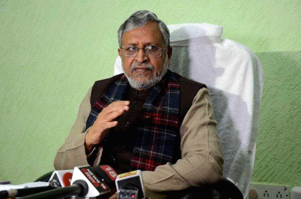 Bihar Deputy Chief Minister Sushil Kumar Modi talks to media persons regarding the interim budget 2019, in Patna on Feb 1, 2019. - Sushil Kumar Modi
