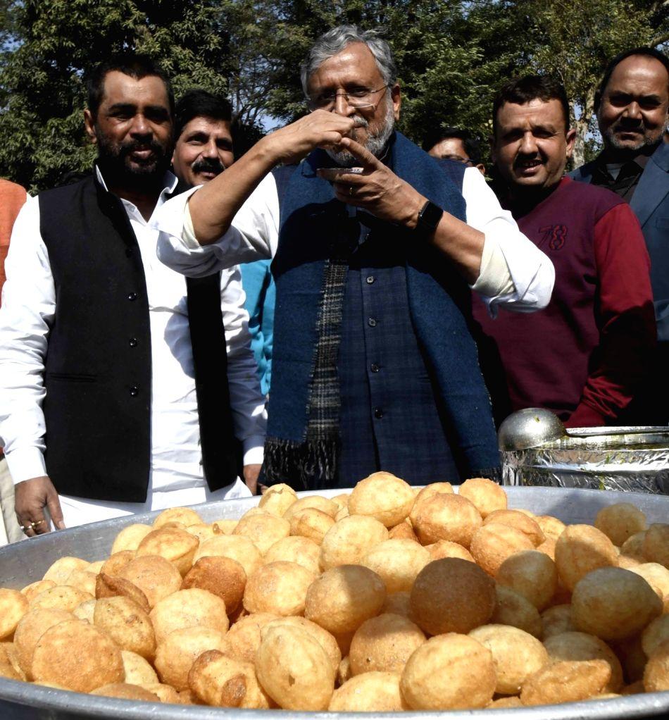 Bihar Deputy Chief Minister Sushil Kumar Modi relishes 'pani puri' during a function in Patna, on Feb 5, 2019. - Sushil Kumar Modi