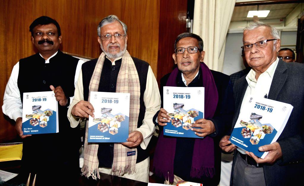 Bihar Deputy Chief Minister Sushil Kumar Modi releases Bihar Economic Survey 2018-19 in Patna on Feb 11, 2019. - Sushil Kumar Modi