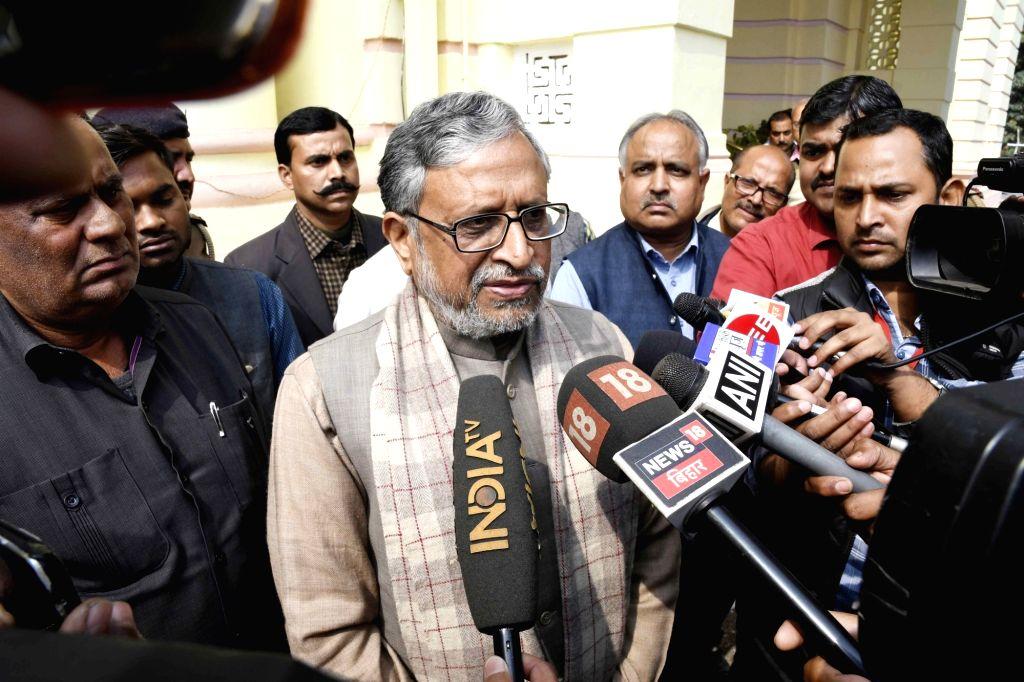 Bihar Deputy Chief Minister Sushil Kumar Modi talks to media arrives at state assembly to present 2019-20 budget in Patna on Feb 14, 2019. - Sushil Kumar Modi
