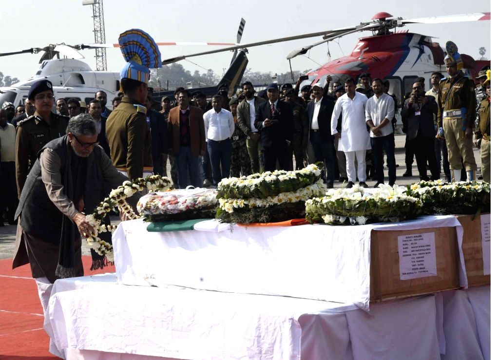 Bihar Deputy Chief Minister Sushil Kumar Modi pays tribute to martyrs Ratan Kumar Thakur and Sanjay Kumar Sinha, who were among the 49 CRPF personnel killed in 14 Feb Pulwama militant attack, ... - Sushil Kumar Modi, Kumar Thakur and Sanjay Kumar Sinha