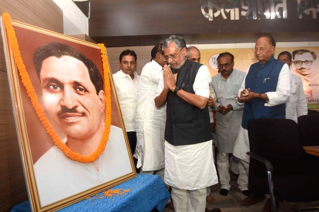 Bihar Deputy Chief Minister Sushil Kumar Modi pays tributes to Pandit Deendayal Upadhyay on his birth anniversary in Patna on Sep 25, 2019. - Sushil Kumar Modi and Pandit Deendayal Upadhyay