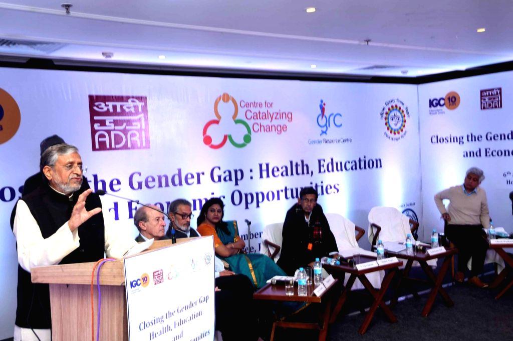"Bihar Deputy Chief Minister Sushil Kumar Modi addresses during a seminar on ""Closing the gender gap - Health, education and economic opportunities"" in Patna on Dec 6, 2019. - Sushil Kumar Modi"