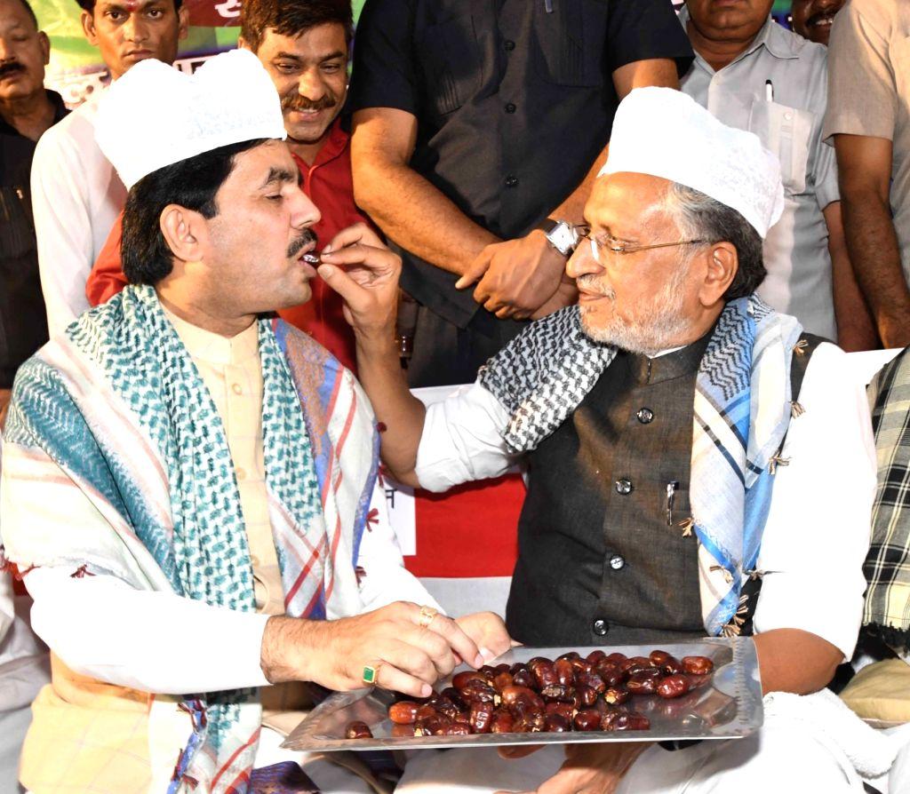 Bihar Deputy Chief Minister Sushil Kumar Modi and BJP national spokesperson Syed Shahnawaz Hussain during an Iftar party in Patna, on June 2, 2019. - Sushil Kumar Modi