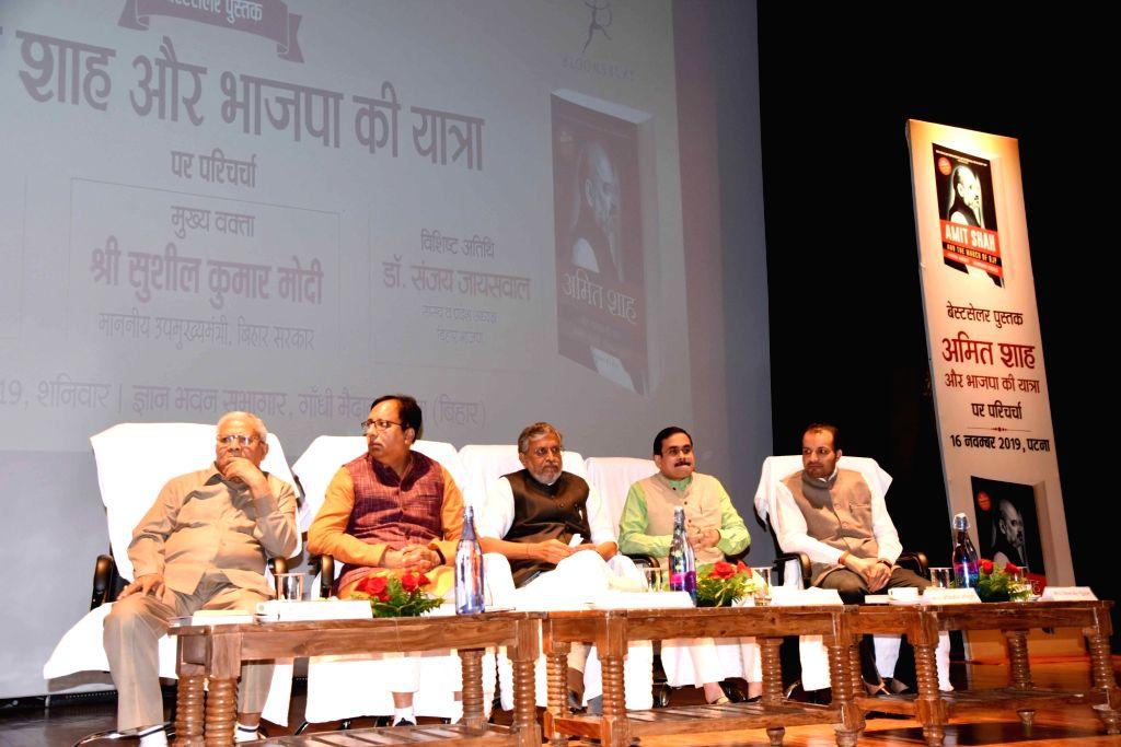 "Bihar Deputy Chief Minister Sushil Kumar Modi and BJP leader Sanjay Jaiswal and other dignitaries with author Anirban Ganguly at the launch of his book ""Amit Shah Aur Bhajapa Ki ... - Sushil Kumar Modi"