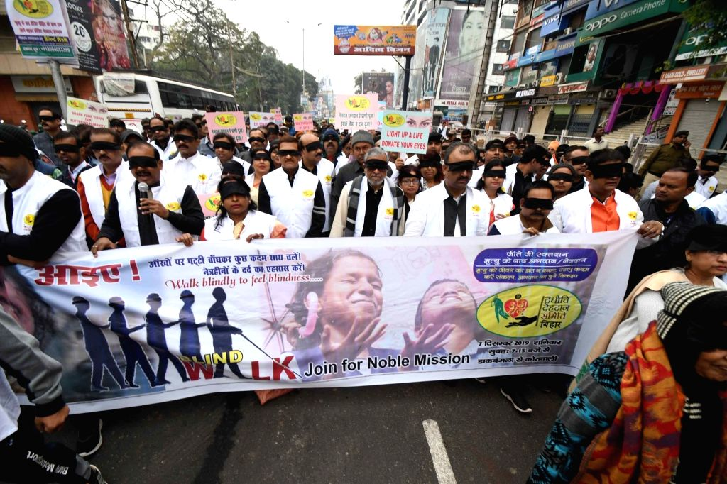 Bihar Deputy Chief Minister Sushil Kumar Modi and Health Minister Mangal Pandey walk blindfolded during 'blind walk' organised as part of an awareness programme in Patna on Dec 7, 2019. - Sushil Kumar Modi and Mangal Pandey