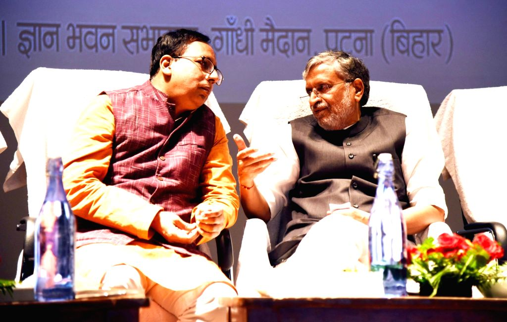 "Bihar Deputy Chief Minister Sushil Kumar Modi in a conversation with BJP leader Sanjay Jaiswal at the launch of Anirban Ganguly's book ""Amit Shah Aur Bhajapa Ki Yatra"" in Patna on ... - Sushil Kumar Modi"