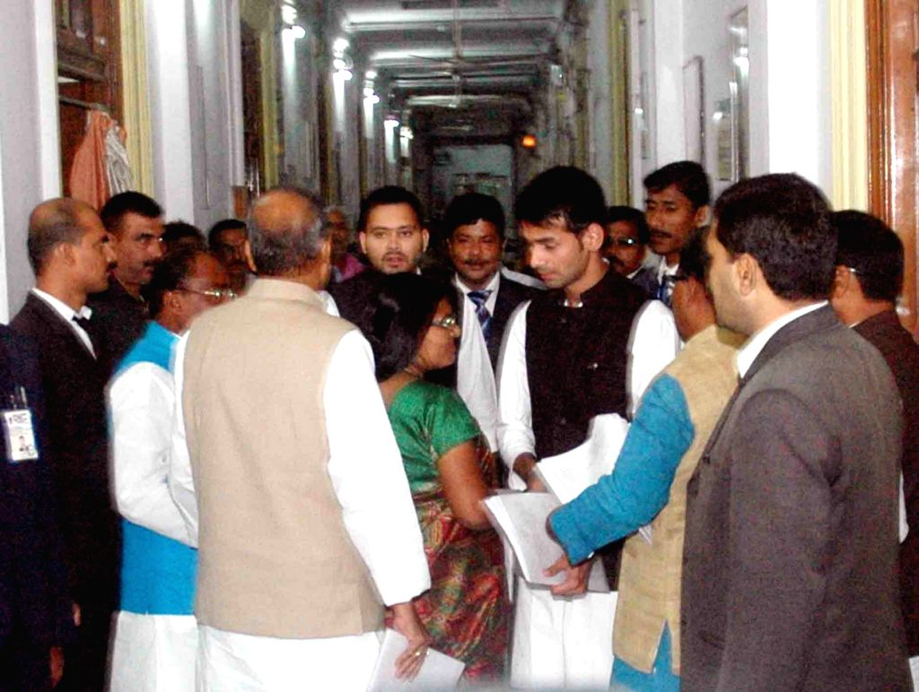 Bihar Deputy Chief Minister Tejashwi Yadav and Health Minister Tej Pratap Yadav arrive at the secretariat in Patna on Nov 21, 2015.