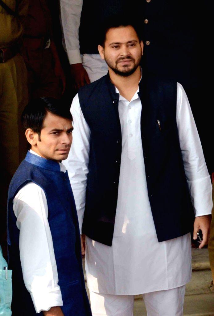 Bihar Deputy Chief Minister Tejashwi Yadav and Health Minister Tej Pratap Yadav arrive at the Bihar Vidhan Sabha in Patna on Nov 30, 2015. - Tejashwi Yadav and Tej Pratap Yadav