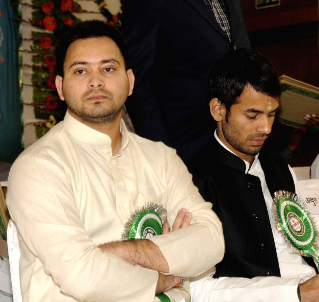 Bihar Deputy Chief Minister Tejashwi Yadav and Health Minister Tej Pratap Yadav during RJD programme in Patna, on Jan 16, 2016. - Tejashwi Yadav and Tej Pratap Yadav