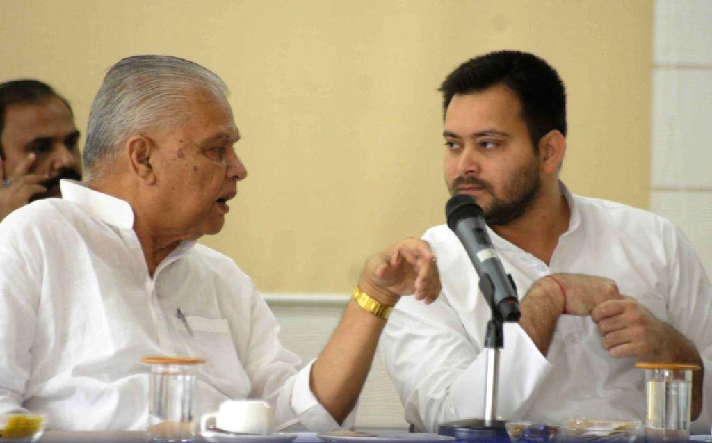 Bihar Deputy Chief Minister Tejashwi Yadav in conversation with Bihar Energy Minister Bijender Prasad Yadav during a program in Patna on July 3, 2017. - Tejashwi Yadav and Bijender Prasad Yadav