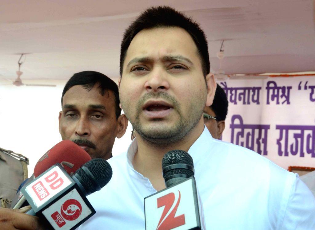 Bihar Deputy Chief Minister Tejaswi Yadav talks to press regarding the arrest of Bihar State Examination Board chairman Lalkeshwar Prasad Singh in Patna on June 20, 2016. - Tejaswi Yadav and Lalkeshwar Prasad Singh