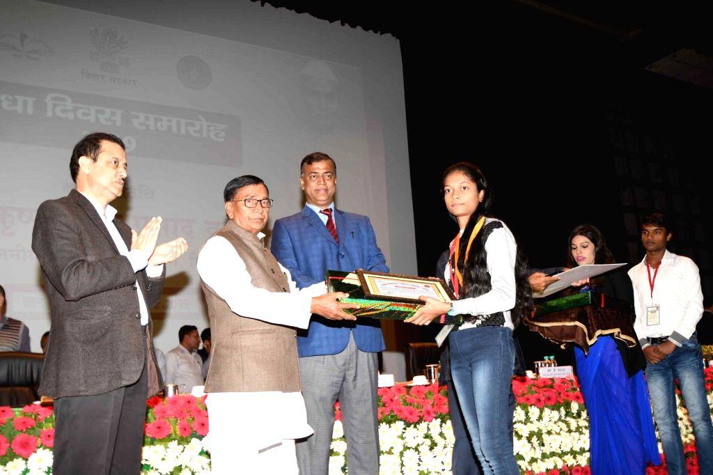 Bihar Education Minister Krishna Nandan Prasad Verma felicitates meritorious students during a programme organised on the 135th birth anniversary of India's first President Rajendra Prasad ... - Krishna Nandan Prasad Verma