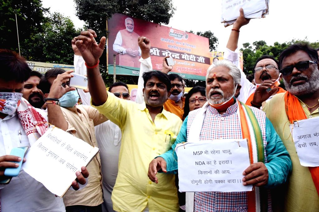 Bihar Farmers and Agriculture Minister Prem Kumar leads a rally in support of the three contentious agriculture-related Bills that have led to agitation by farmers in many states, in Patna on ... - Prem Kumar