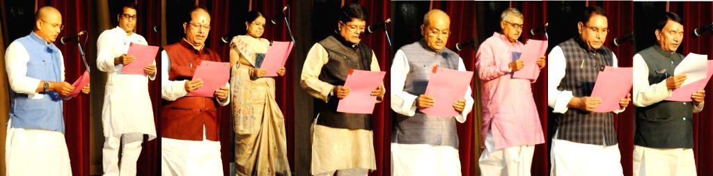 Bihar Governor Keshari Nath Tripathi administering oath to legislators as state cabinet minister during the swearing in ceremony; in Patna on July 29, 2017. - Keshari Nath Tripathi
