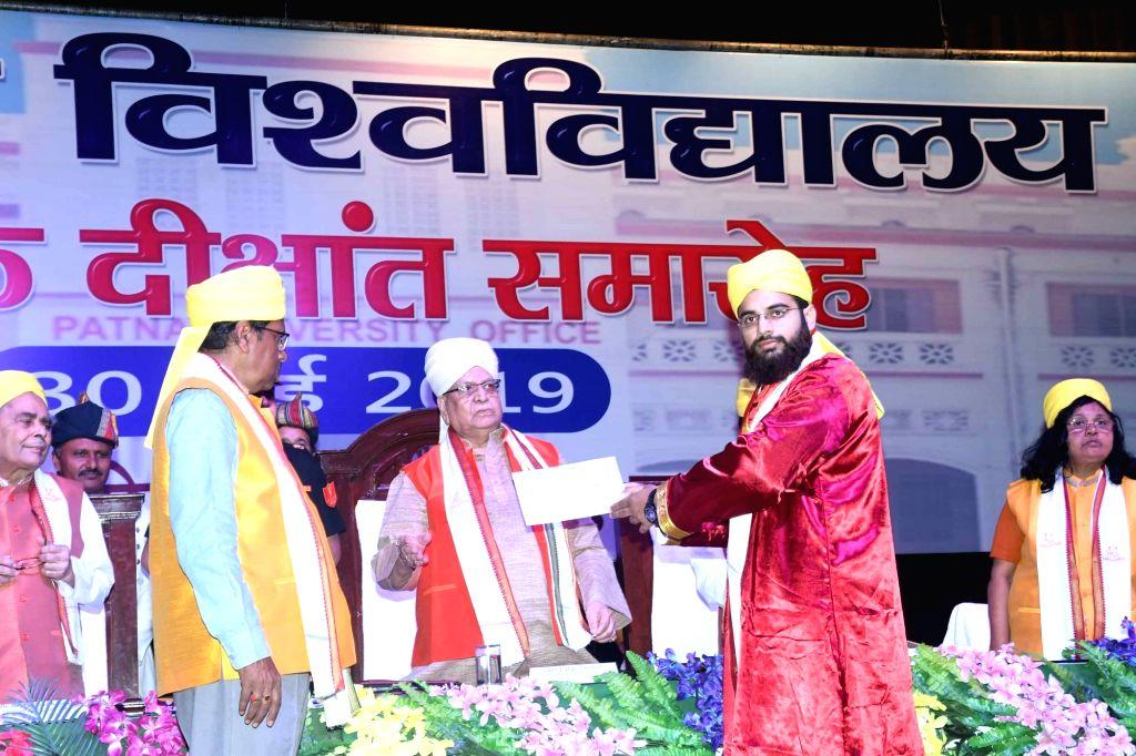 Bihar Governor Lalji Tandon presents degree to a student at the convocation of Patna University, on May 30, 2019.